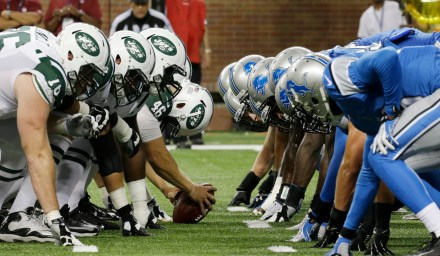 The New York Jets and the Detroit Lions face off during the third quarter of an NFL football game at Ford Field in Detroit, Friday, Aug. 9, 2013. (AP Photo/42011000001)